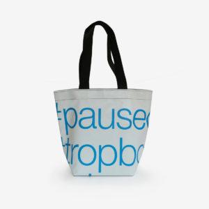 sac cabas en bâche publicitaire blanc typo bleue