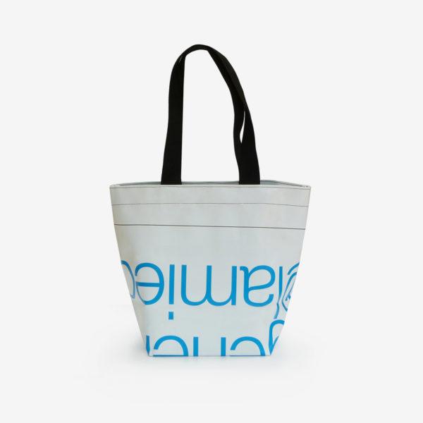 Dos sac cabas en bâche publicitaire blanc typo bleue.
