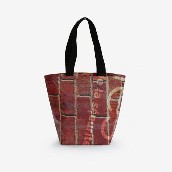 Dos sac cabas en bâche publicitaire impression mur de briques.