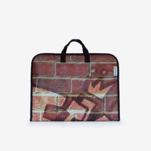 housse ordinateur en bâche publicitaire impression mur de briques