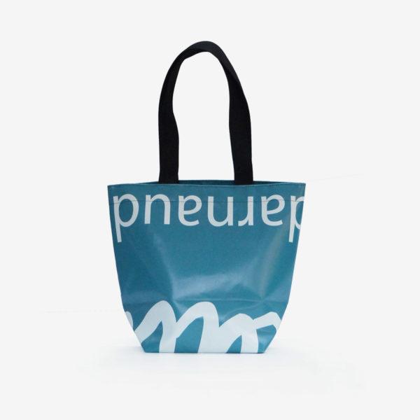 Dos de sac de fille en bâche publicitaire bleu canard.