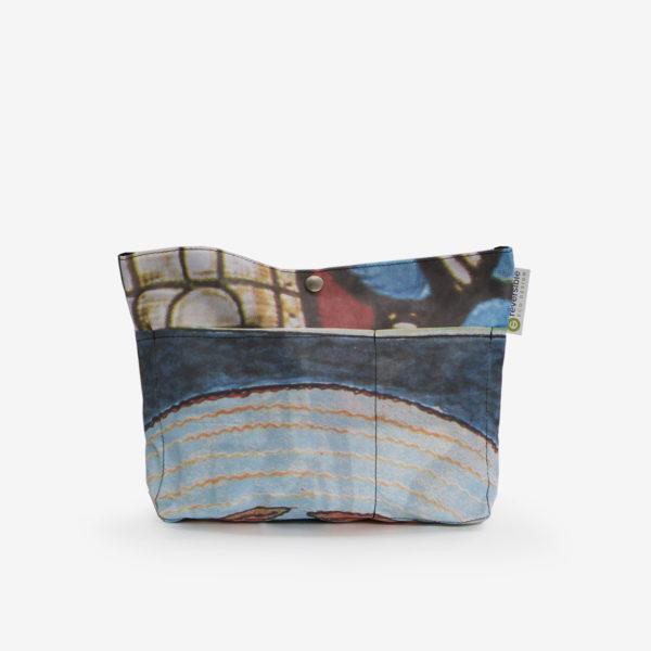 Sac à sac multipoches en toile publicitaire multicolore.