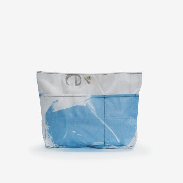 Dos de sac à sac multipoches en toile publicitaire.