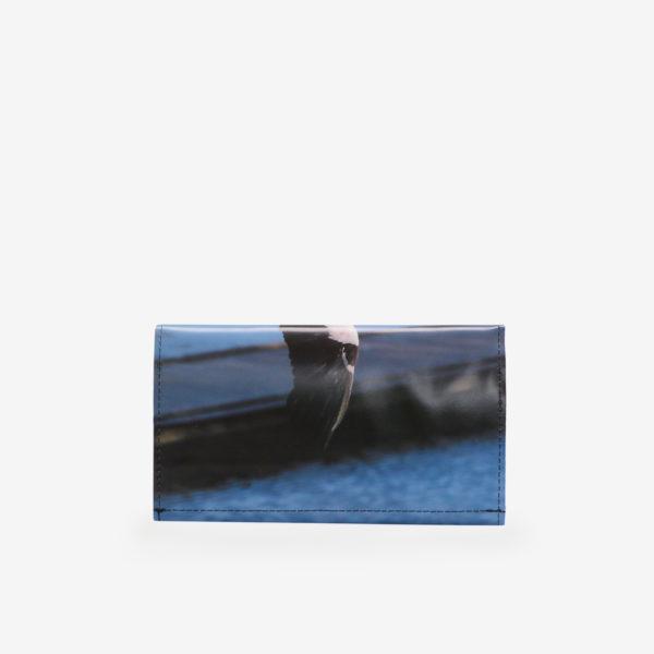 Dos de portefeuille en bâche publicitaire cigogne.