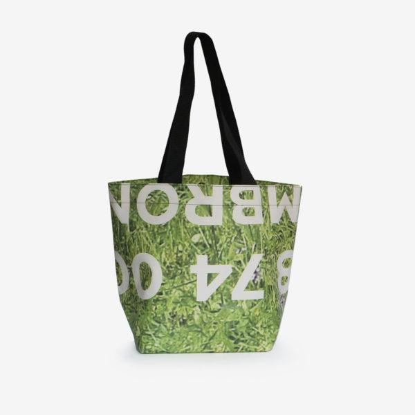 Dos de sac cabas herbe verte en bâche publicitaire.