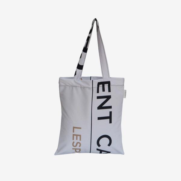 03 Dos de tote bag en toile publicitaire blanche et graphique.