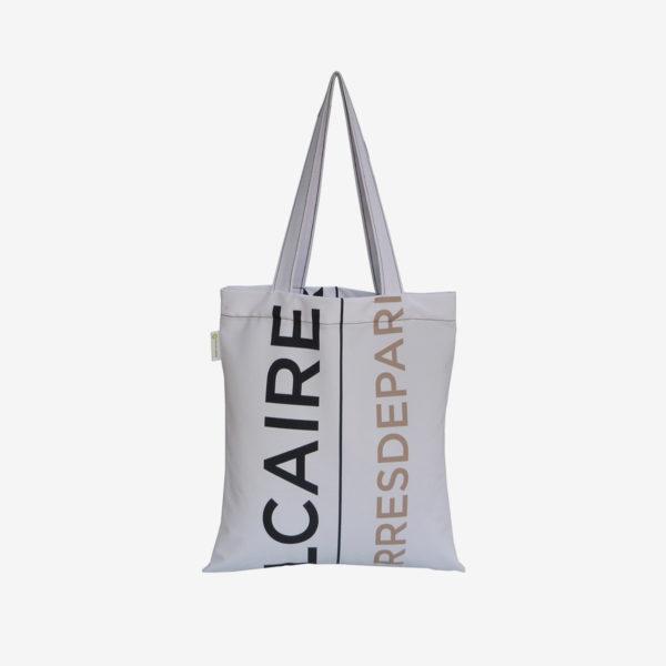03 tote bag en toile publicitaire blanche et graphique.