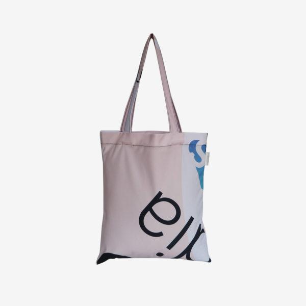 04 Dos de tote bag en toile publicitaire blanche et rose.