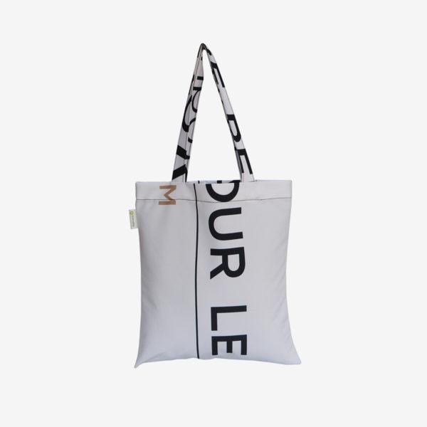 10 tote bag en toile publicitaire blanche et graphique.