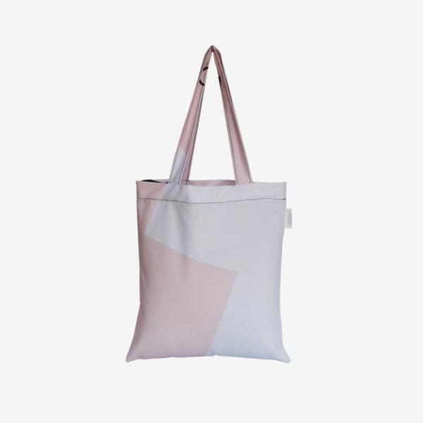 19 Dos de tote bag en toile publicitaire blanche et rose.