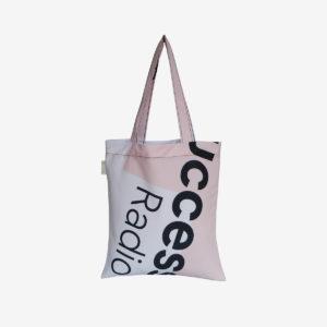 19 tote bag en toile publicitaire blanche et rose.