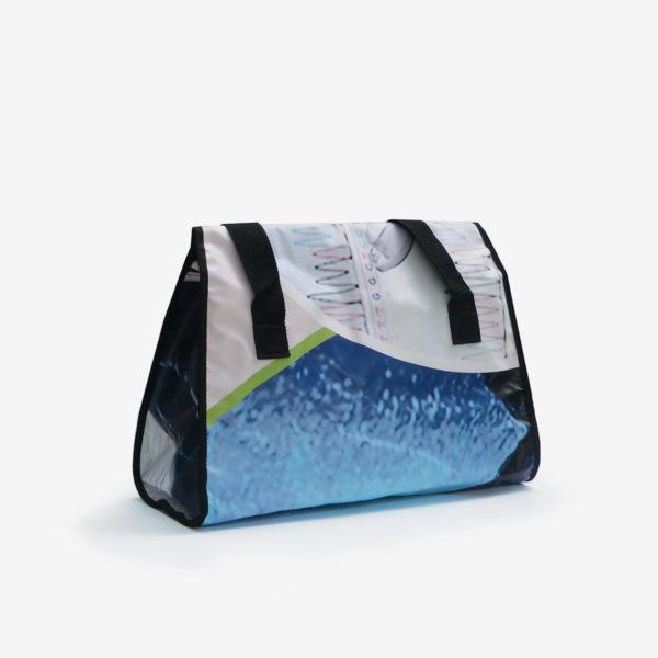 33 dos de Sac en bâche publicitaire recyclée bleue.